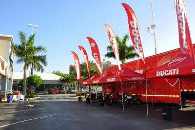 By 5, the beer stand is ready, the Ducati display is arranged and the space is set up for the race bike display