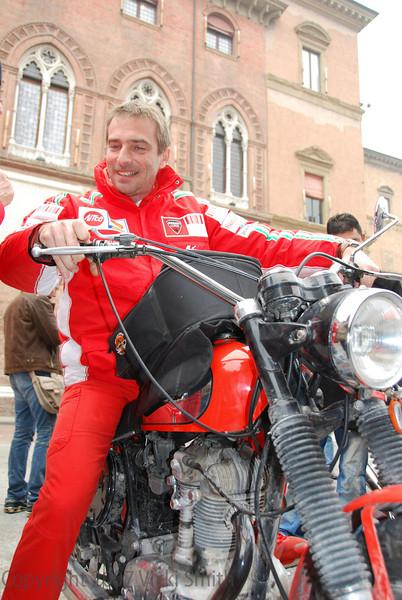 Livio Suppo checks out one of the Scrambler Desmo Owner Club's bikes.