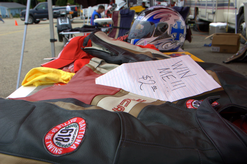 Lots of raffle items including this leather jacket, the helmet in the photo and a day's RV rental.