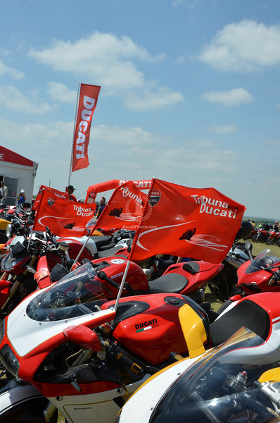 No problem with a breeze either.  That tent destroying wind has simmered down, is keeping the sun at bay and the Ducati flags busy