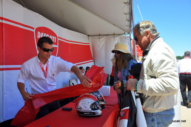 "First stop, Ducati Island gear check.  It's hard to have a good time in the sun wearing or dragging heavy and expensive riding gear. Ducati North America has a fix for that and it's all free to Ducati owners, a ""thanks for your business"" you can really use.<br /> (That's Jeff Schuessler, DNA's promotions manager making sure your stuff stays safe while you play all day)"
