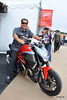 That's Ralph Sheheen, Speed TV's commentator, checking out a Diavel.  Looking good Ralph!