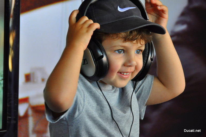 headphones were available to watch the videos, this little guy seemed partial to Hannah Johnson's (The Ducati Master tech's) lean in video (early signs of great taste!)