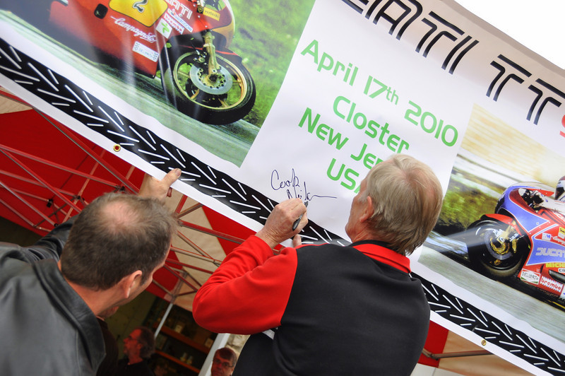 They were all signing autographs, that's Cook Neilson signing the event banner