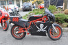 "This bike belongs to Jon Slocum, President of DESMO in NY.  The story is he bought it (maybe I should say rescued) and the paint job that was on it was really, really bad, so the fast solution was to rattle can it so he could ride it.  Ted Gooch called it an F1 ""Arrrrrrgh"", a name which I am certain will stick :-)"