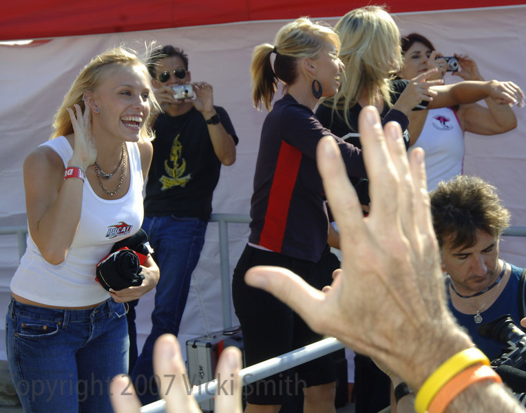 """The t-shirt toss is a tradition, here Rachel tells the crowd """"I can't hear you!!!"""" before she tosses out the last t-'s"""