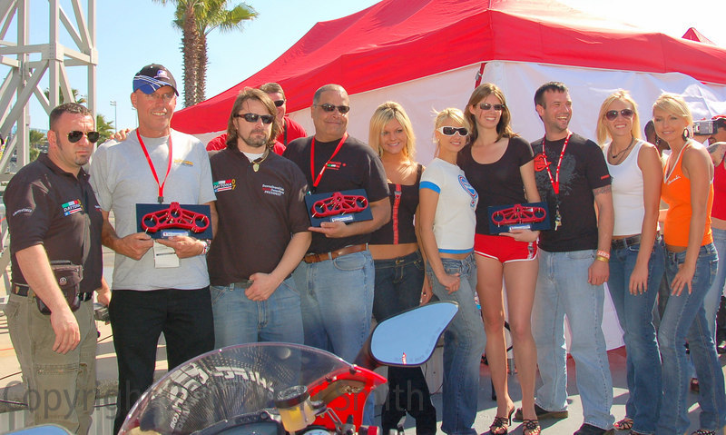 The winners of the Ducati Idol contest pose for the crowd with the judges from the Desmodromiclub of Rome, Italy