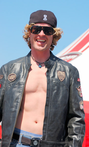 If this guy looks familier it's because that's Jesse Rooke, the custom bike builder. He looks pretty good in Ducati badged leather, maybe his next project will have a desmodromic heart???