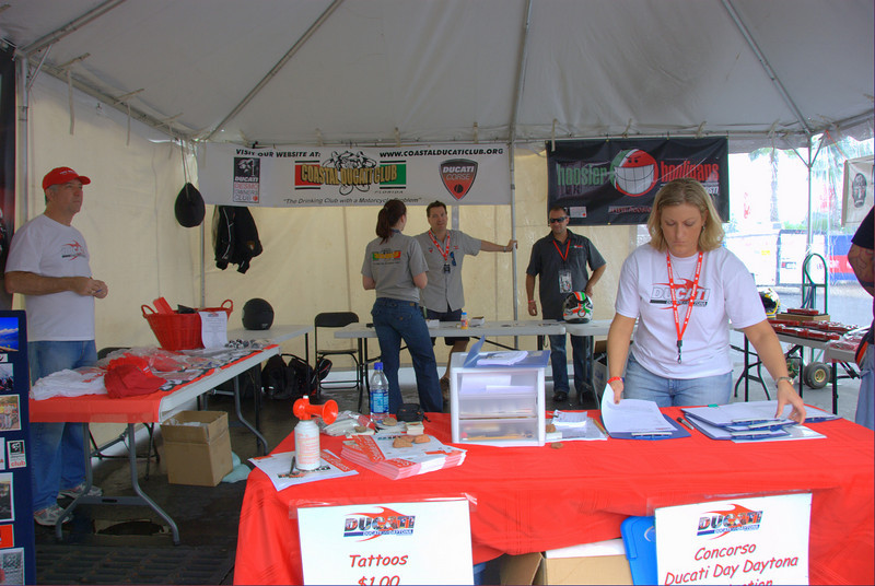 This year we added a Ducati Owners Club tent to the Island. Seven Ducati owners clubs shared the space, with all sorts of club t-shirts and club items for sale.  This was also where you could get a free ticket for the door prize drawings which included items from:<br /> EMS<br /> Rhinomoto<br /> Pure Ducati<br /> NPR Ducati<br /> Lady Ducati DOC<br /> USDESMO DOC<br /> Motorcyclist Magazine<br /> Pirelli<br /> Ohlins