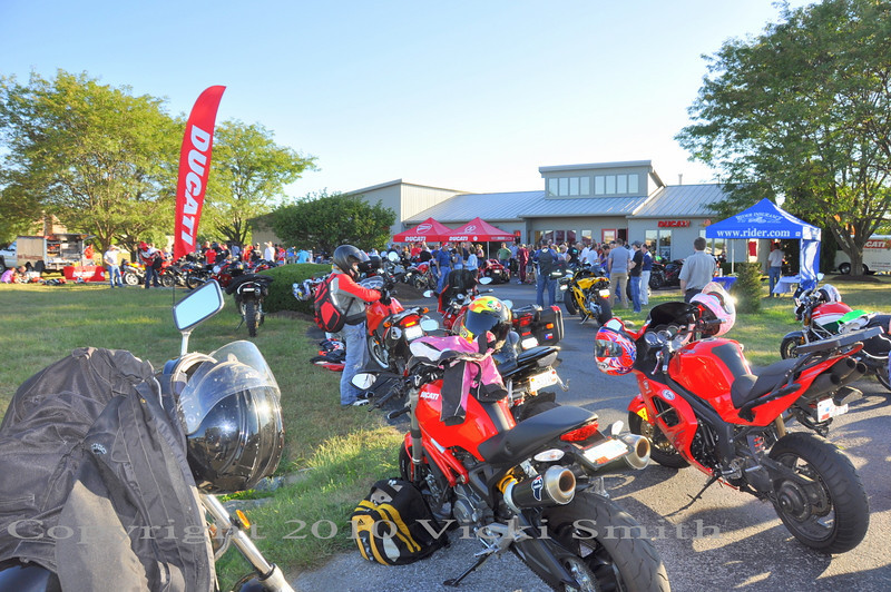 Ducati Indy kicked off the weekend on Thursday evening with an open house.  Nicky Hayden was scheduled to appear and  a big crowd turned out to meet him, hundreds of motorcycles lined the street to the dealership