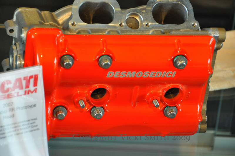 """The glass cases weren't all retro, this D16RR head painted in Qatar """"night color"""" red was on display along with other modern and high tech engine internals"""