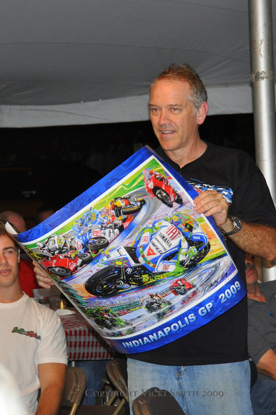 Randy Owens is widely regarded to be the leading automotive/race car artist but he does bikes as well and has long worked with Indy Speedway (this year his was the official poster). He donated some of his outstanding product to the dinner swag pile and even came up to help give it away. Thanks Randy!