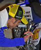 And autographing the bike he was supposed to ride