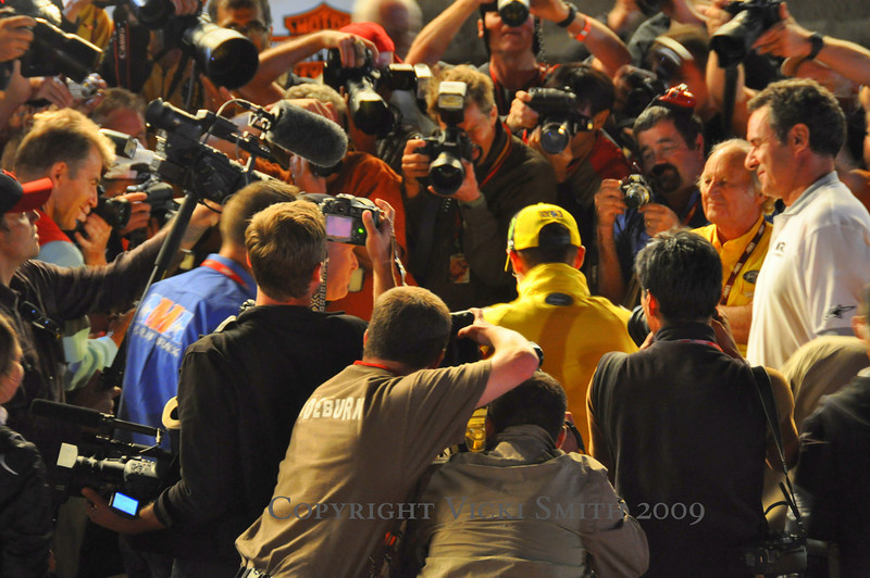 When it was all over, Rossi jumped off the photo stand and went down into the crowd to check out the TZ. To say it was a media frenzy is an understatement (click to enlarge for the full scale of the madness)