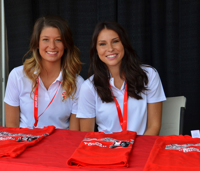Friday morning.  First order of business, check in at the Ducati grandstand and pick up your grandstand kit from these ladies......