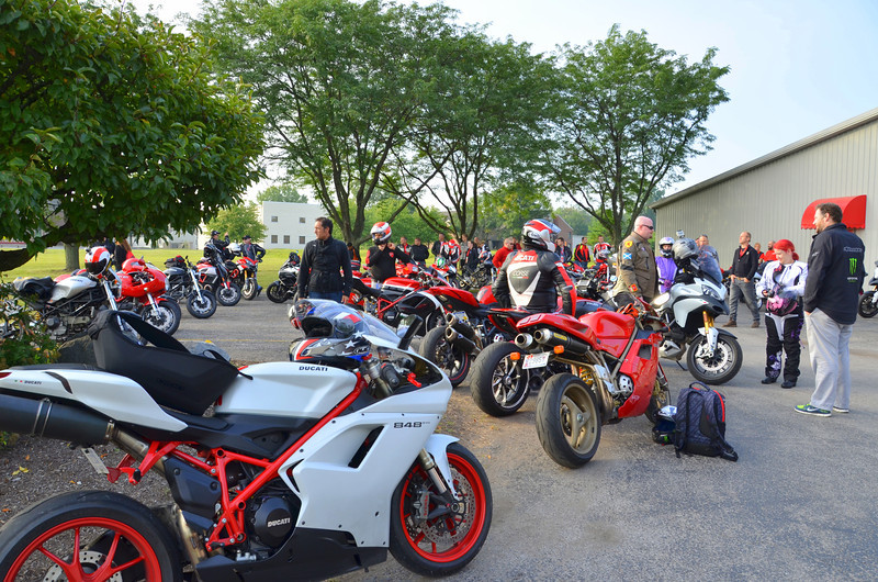 Meet up at Ducati Indy, gather behind a police escort and head for the track.