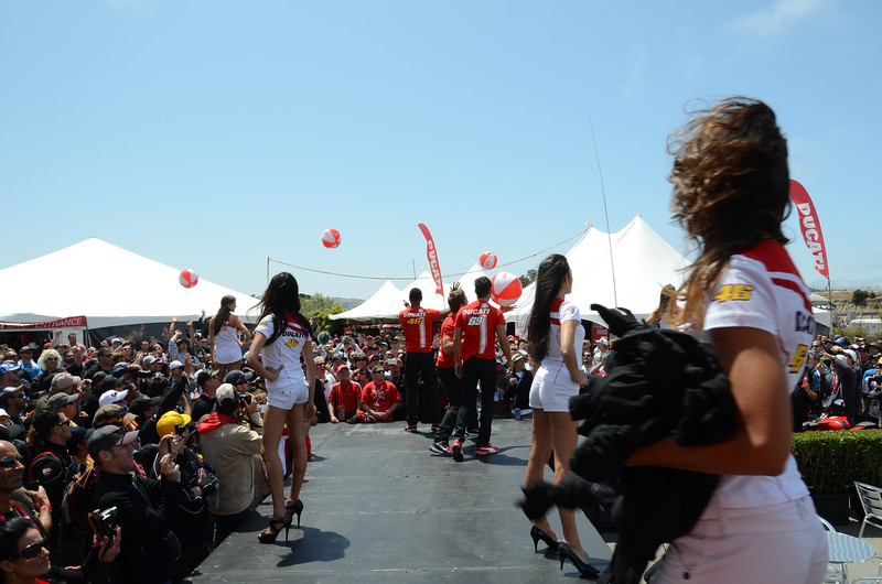 The models toss t-shirts and beach balls into the crowd