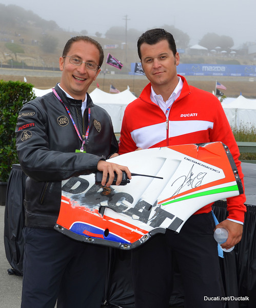 Stefano and Jeff show off a donated item in the Make A Wish Auction