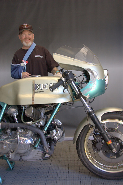 "Keith Hale and his 100,000 mile 750 Super Sport ""Green Frame"". Keith had a get off on the way to the track, which scraped the fairing and broke the windshield. The bike arrived on a flatbed but he left it in the contest. Somehow it just added to it's panache."