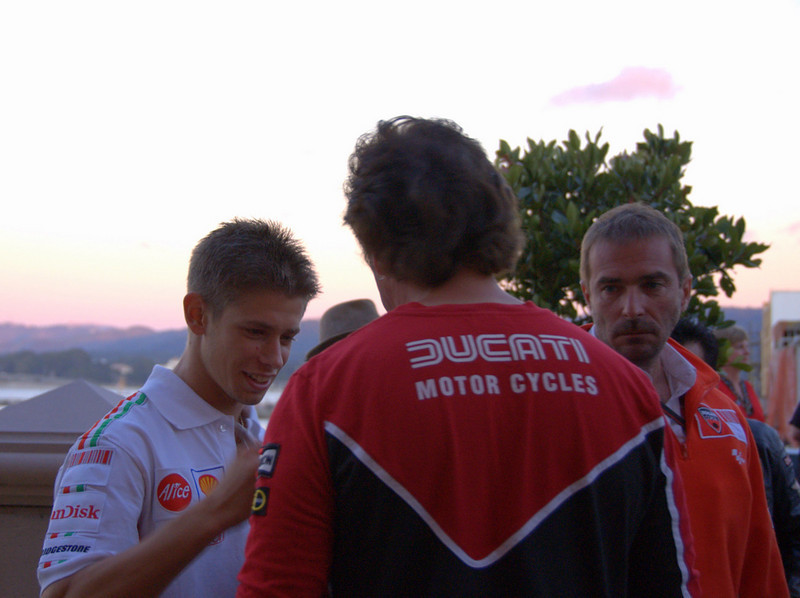 Superbike Concorso judge and Ducati Dealer Jeff Nash chats with Casey Stoner and Livio Suppo at the party