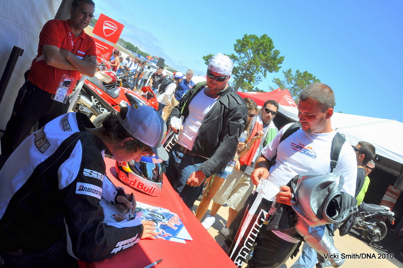 After a stunting trip around the racetrack he came to the island to sign autographs