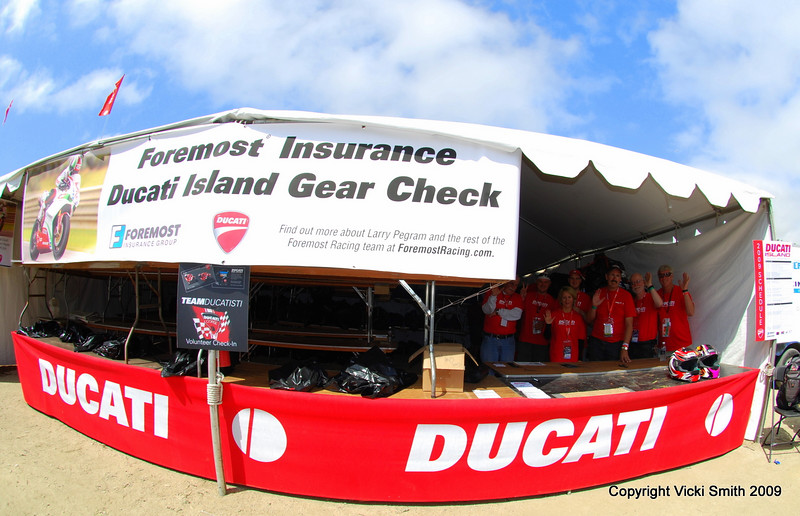 "First stop, the Foremost Insurance gear check.  Foremost believes in smart riders who wear good gear and they are very much aware how much we invest in it (these guys ""get it"", Foremost standard coverage includes track days and realistic $$ gear replacement) so sponsoring a safe place for folks to stash gear was a natural fit.  Staffed with hard working ""Team Ducatisti"" volunteers (thanks guys!) it's a quick stop to shed some weight and now it's time to see what's going on."