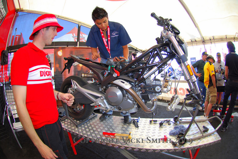 The crew from Wyotech is disassembling a Ducati Monster to entertain the crowd. Ducati North America National Technical Manager Austin Gray is on hand to answer questions