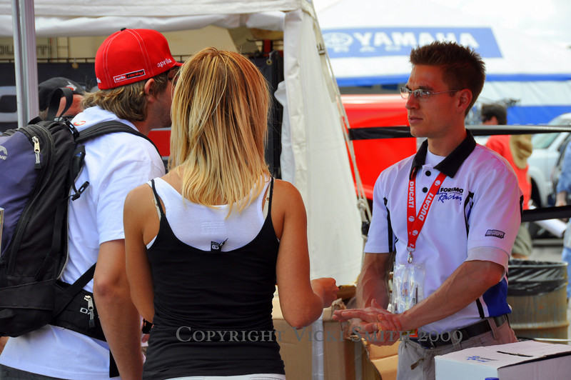 """That's Brett """"We cover track days"""" Krynak in the Foremost Insurance booth.  He's an interesting guy, when he's not going to bat for things like automatic track day coverage and $2500 gear replacement (things that matter most to Ducati owners) he's jumping out of airplanes and chasing whales."""