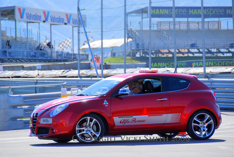Things you don't see every day:  Custom Candy Apple Red Alfa Mitos twinkling in the sun....