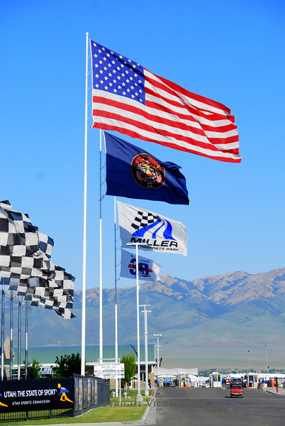 Miller Motorsports Park.  It's big here. Everything about it is built on another scale.  From the hundreds of giant flags that line the front gate to the 4.5 mile track surrounded by mountains, it's all designed to make you work to grasp the scale of it.