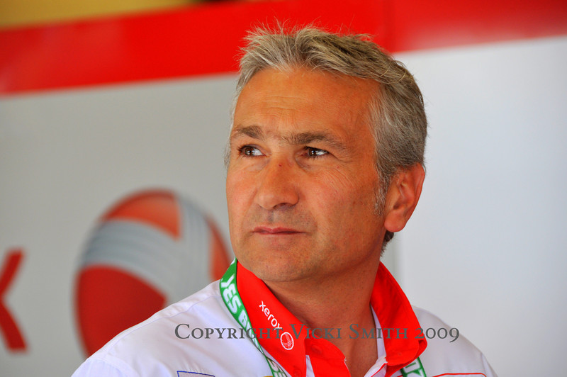 "That's Davide Tardozzi.  He's the boss of Ducati Corse SBK but he's no stranger to ""getting 'er done"". A past SBK star himself, he's got 5 wins and a couple of pole positions of his own"