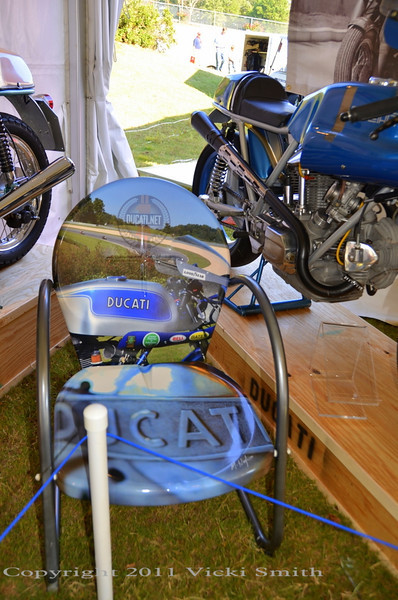 "This chair was done by Ducati artist Mark Hoyt as a gift to me, using my photos from a past Barber event, of the bike Rich built, ""Deja Blue"".  Thanks Mark, it's really, really cool."