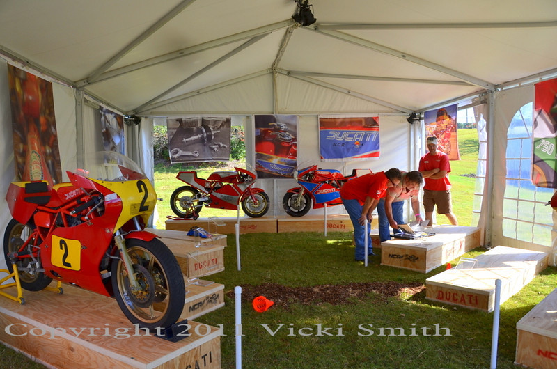 hang the graphics, haul the boxes, place the bikes, hammer in stantions..... it's starting to come together