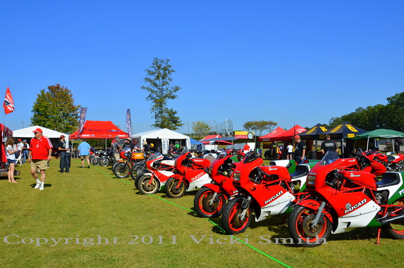 "The bike show was on Saturday, but because we had so many pre-entries (almost 100) it was possible to lay out the field by decade and allow the entries to park there all weekend, creating an ""evolutionary display"""