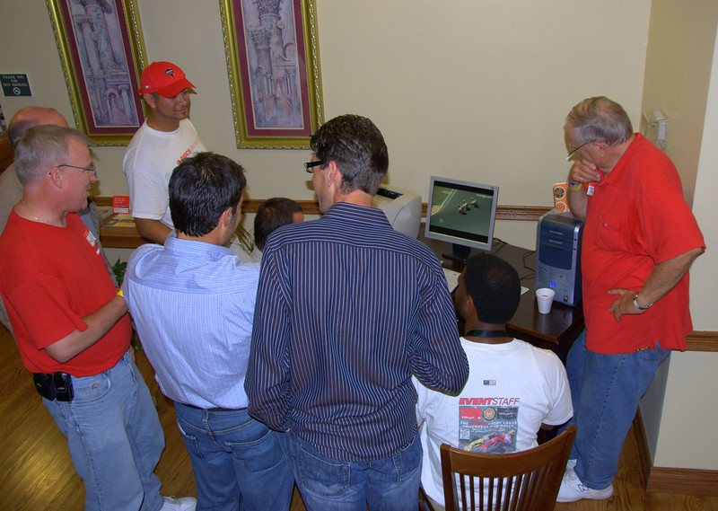 Motogp was playing on the lobby computer all night.  Here the group is debating the 250 race from the week before