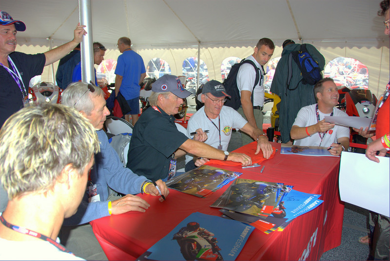 Rider signings were huge crowd favorites.  Casey Stoner, Marco Melandri, the Ducati Alice Team of Toni Elias and Sylvain Guintoli, and these guys (from left) Larry Pegram, Phil Schilling, Cook Neilson, Paul Smart and Greg Tracy