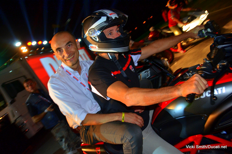 Claudio Domenicali on the back of Troy Bayliss Diavel