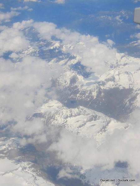 It always starts here. Looking out the airplane window at the snow capped Italian Alps.  My adventure is about to begin.....