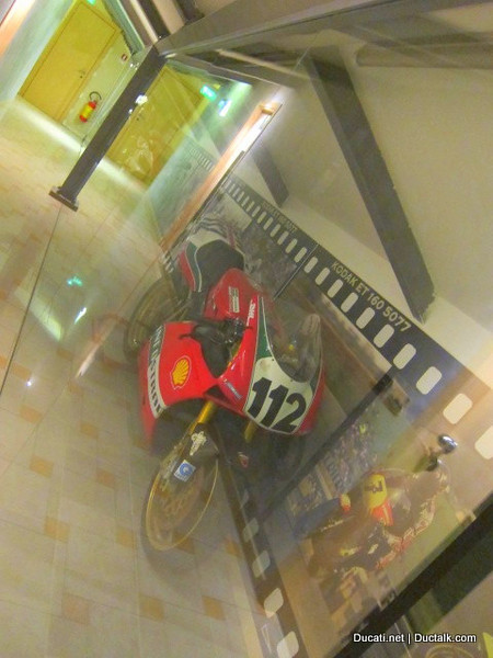 Sure enough, there's a giant glass case with leathers, racebikes and all sorts of cool stuff displayed in it. Nice!