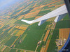 It looks different here, the farms and fields and colors of the land of the region of Emilia-Romagna. Almost there - In ten minutes you will be walking across the runway, boarding a bus to the terminal