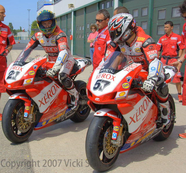 Troy Bayliss and Lorenzo Lanzi take to the track
