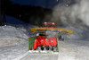 Four Ducati Desmosedici GP13 MotoGP bikes are transported by a snowcat.