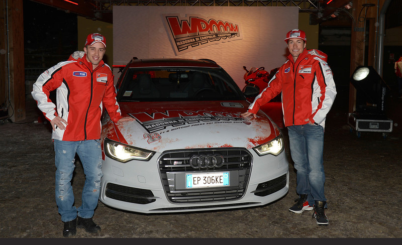 Andrea Dovizioso (left) and Nicky Hayden pose with an Audi upon arrival at the 23rd edition of Wrooom.