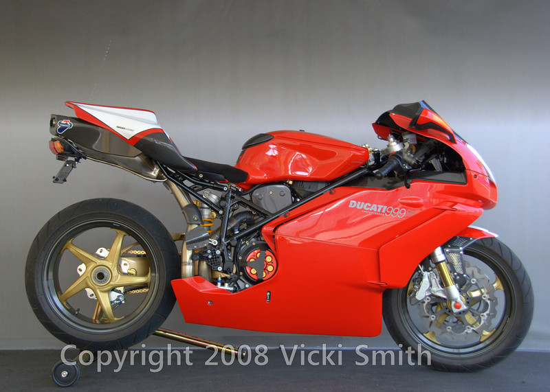 "Ben Bhimjee's 2003 999<br /> <br /> Winner of DucatiDayDaytona 2007 ""Designers Choice"" award from 1098 designer Gianni Fabbro. Added equipment includes: Carbon Fiber: Dymag Front and Rear Wheels, Front Fender, Front Nose Air Deflectors, Timing Belt Covers, Air Tube Covers, Oil Cooler Cover, Key Guard, Tank Guard, Heel Plate, Mono seat unit, Exhaust Box Cover. CNC Billet : Adjustable Race Rearsets, Clutch Cover, Fuel Cap, Clutch Slave, Rear Brake Reservoir, Large Frame Plugs, Sprocket Cover, License Plate Relocator. Magnesium Single Sided Swing Arm, Braking Wave Rotors Front and Back, Ohlins Rear Shock, Ohlins Reworked Forks, Ohlins Steering Damper, Brembo Radial Brakemaster, Gold Chain. Tramagoni 50MM Full Exhaust, Hi-Compression Drop In Pistons, Stainless Steel Spring Kit, Slipper Clutch. Suede Seat Pad, Front and Rear Number Plates."