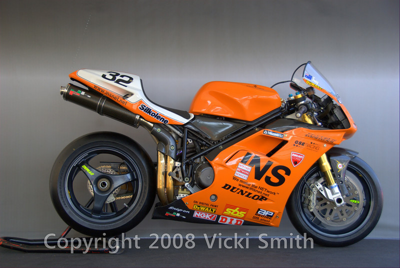 And the winner is.....  Douglas Frederick and Ann Cederna's Bayliss BSK Ducati:<br /> <br /> 1998 Ducati Factory Corse 996: GSE/INS British Superbike, Horsepower: 162 (at rear wheel) For the 1998 and 1999 season, JHP built engines for the GSE/ INS British Superbike team. Engines were originally provided by Ducati Corse race shop, after which all engines were taken completely apart to check tolerances and build to specifications. Maintenance and rebuilds were regularly undertaken per race weekend for a religious schedule of maintenance and scrutiny. The racing team removed engines and replaced them as supplied and maintained by JHP, with the results that brought the championship trophy in 1999. History: 1998 - Raced by Troy Bayliss for GSE/INS British Superbike, 1999 - Used early in 1999 campaign as team waited on updated factory Corse, 2000 - Sold to John Ward, 2001 - Sold to present owner, 2002/2003 - Restored by John Hackett Performance/Ducati Coventry.The bike described here was used in the 1998 campaign (the campaign preceding Troy's Championship winning year - 1999). Both 98 bikes were re-painted from the original yellow livery to the orange livery for photo-shoots to launch the 1999 season (the team was waiting for the 1999 Corses). Additionally, the bike was used for the Misano, Italy test session in February 1999. Equipment - Dymag Wheels, AP Racing Brakes (Front and Rear), Stainless & Carbon Fiber Exhaust, 60 MM Throttle Bodies, Deep Sump Engine, Magnetti Marelli Fuel Injection (Lambda sensors @ Exhaust/Throttle/RPM/Alternator), Large Airbox (the 1999 airbox was 30/40 percent larger) , JHPerformance/ Ducati Coventry: Tuning Support and Engines