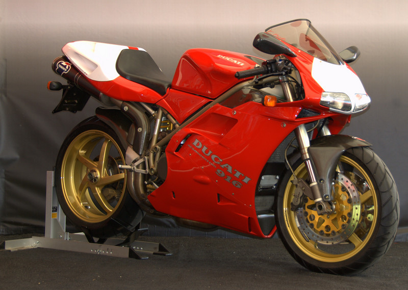 Tom Perko's ultra rare 1997 916SPS.  Considered by many to be the most collectable version of the 916 (it was the homolagation bike for the first use of the 996 cases and the basis for the most successful racing Ducati in history). This one was rewarded with the Troy Bayliss Award.