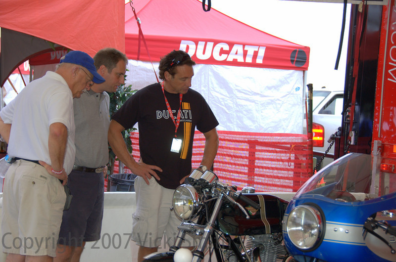 More judging - Brian Slark, Rich Lambrechts and Jeff Nash compare notes while looking at Mike Cecchini's 750 custom