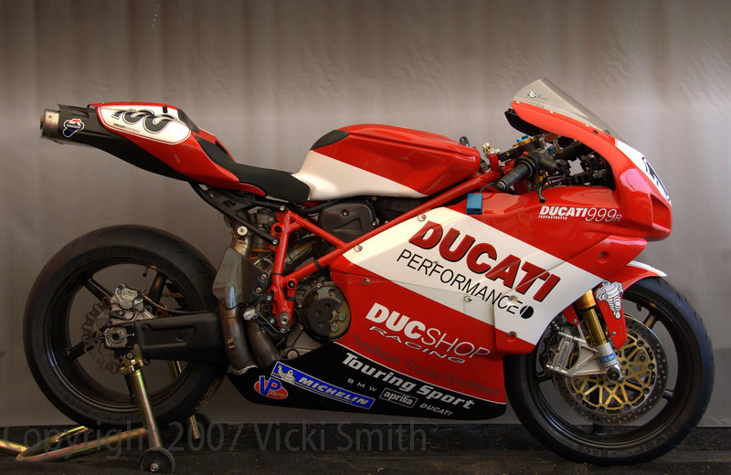 Ducati Erv's 2005 999R:<br /> <br /> Ducshop Ducati '05 999R race bike as featured in winter 2005 issue of ATLANTA MAX. Blueprinted motor for race conversion by Mark Sutton at Ducshop in Atlanta, GA to provide nearly 160 rwhp. Upgrades incl: Engine:Balanced & blueprinted crank,Balanced & blueprinted transmission,Super-sport competition valve job,Milled heads,Degreed cams,Pistal 13:1 pistons,Pankl billet Ti rods,Termignoni 62mm full-race Corse SBK exhaust Corse reed valve Dynojet PCIII USB Power Commander w/ custom map Quick-turn throttle conversion Corse slipper clutch (6-spring) 520 ERV3 chain / aluminum sprocket DucShop billet triple clamp Ohlins DU301 rear shock Ohlins steering damper Lightened rear rotor Brembo GP billet brake & clutch pump Corse rearsets Body:Corse sub frame,Corse tail section,Sharkskinz bodywork,Aluminum upper fairing support,Carbon vented clutch cover,NCR gascap,Dynojet power shifter w/ GP shift pattern BST carbon wheels & Bremobo floating brake rotors