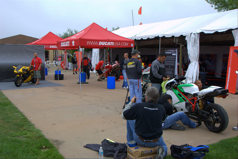 Set up includes checking in each bike, passing out gift bags and having a pro photographer shoot each bike as it arrives. That's Steve Leukenech shooting Rick Henry and his Ducati 996.