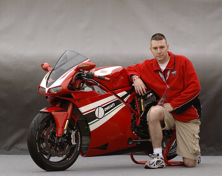 Steve Golladay came with Rick from Las Vegas. Here's what he has to say about his 2002 998:<br /> <br /> An incredibly powerful 999R engine serves as the heart of my custom 998 build and is truly something special! Just some of the engine upgrades include CP high compression pistons, Pankl titanium rods, racing crank, Corse close ratio gearbox, magnesium clutch and valve covers, and Akrapovic 57mm ceramic coated exhaust system. The chassis components have been modified with two major goals: weight reduction and improved handling. The major chassis changes include BST Carbon Fiber wheels, Ohlins R&T forks with Superbike internals, Ohlins rear shock with top-out spring, Brembo GP clutch and brake master cylinders, Brembo radial calipers, fully floating rear rotor, custom billet rear brake caliper, and 27mm offset upper and lower triple clamps.The carbon fiber bodywork was chosen specifically for its aggressive and unique features. Some of the other carbon fiber pieces include airbox, air runners, mirror supports, headlight bucket, and timing belt covers. Many parts have been custom anodized to match the overall color scheme. The fork tubes and rearsets for example contribute to the aggressive visual statement. Combining a 999R with a 998 provided a fantastic challenge to overcome. Just seeing the 999 series instrument cluster mounted atop the 998 dash area is a striking visual statement. You cannot help but be drawn in for a closer look at how the pieces come together in such an artful way. It has been an honor building this bike incorporating the best in Italian design and aftermarket performance parts. My passion for Ducati during this project has given me an extremely high appreciation for the history and lineage of the company.